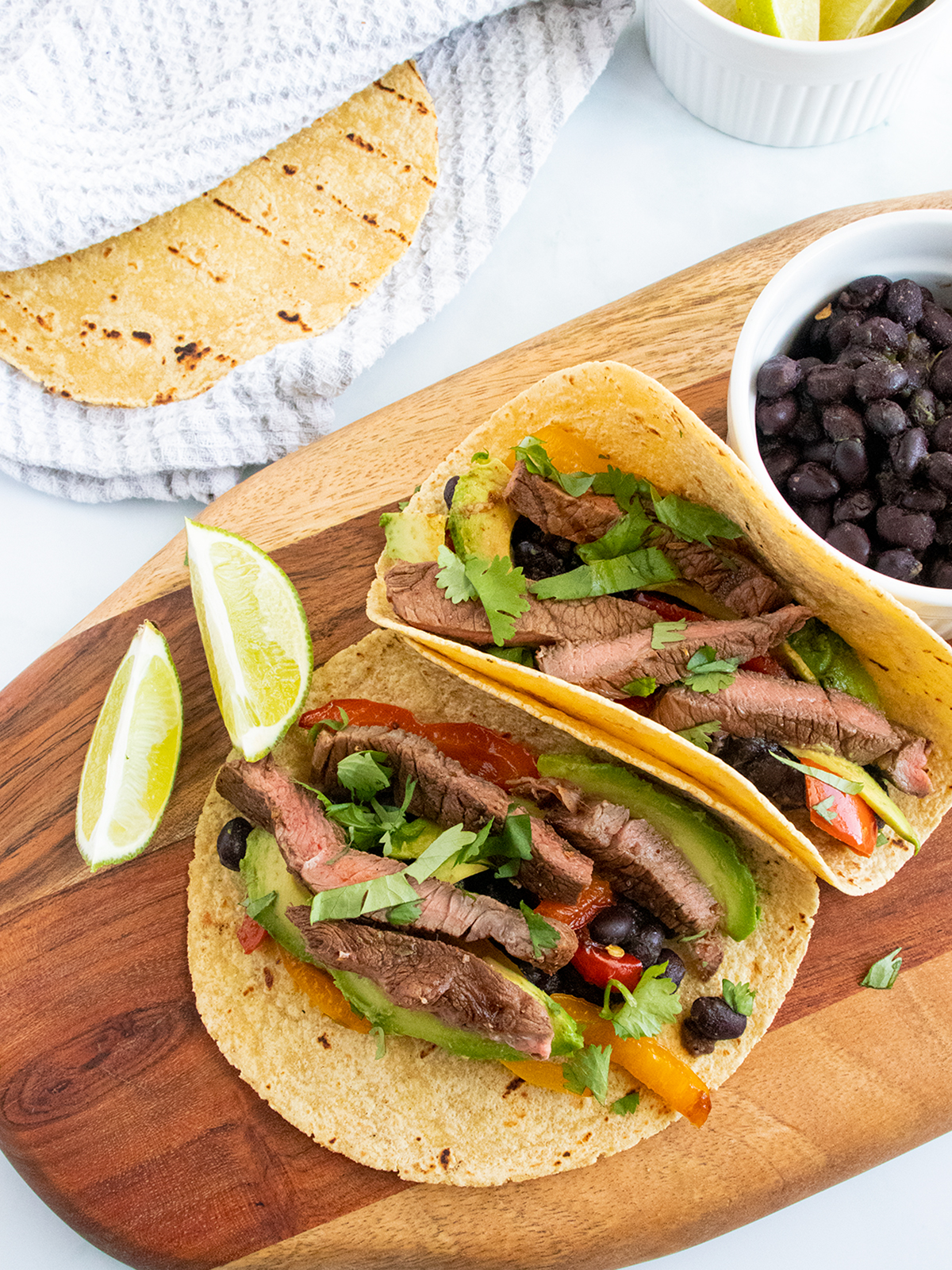chipotle steak tacos topped with cilantro and lime