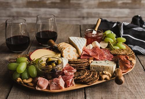 https://media.istockphoto.com/photos/close-up-of-charcuterie-board-and-glasses-of-wine-on-wooden-table-picture-id1207578766?b=1&k=6&m=1207578766&s=170667a&w=0&h=1YZW1AwK7_bZnd47Irk9iEjeB0lMJEkbsaZu1xVVJGI=