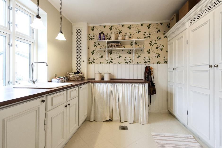 white cabinets in a kitchen as a way to add more vertical storage space