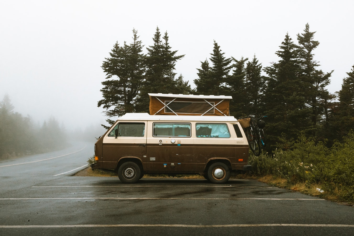 Campervan parked in the rain in Acadia National Park; convert a van for camping