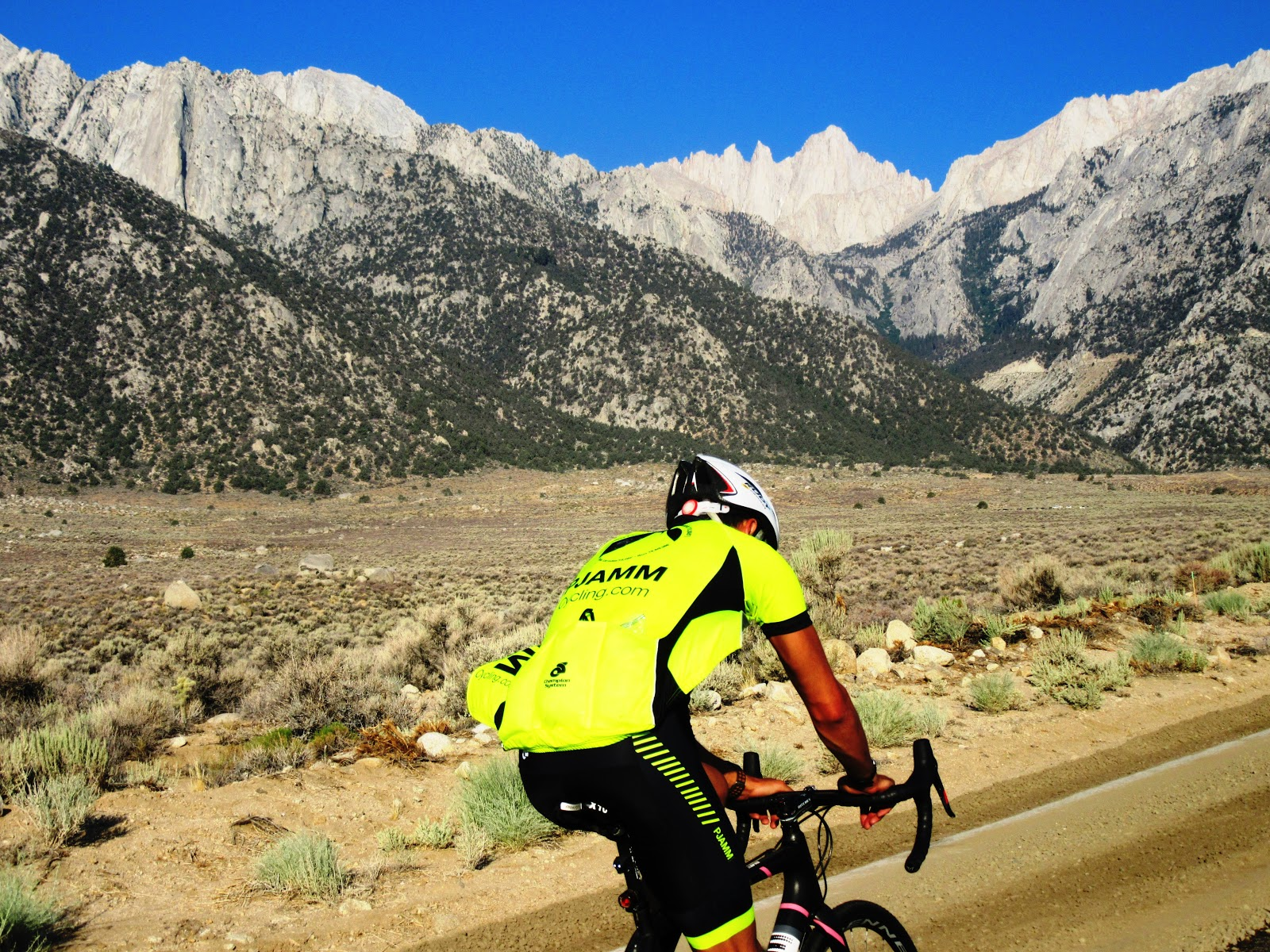 Cyclists riding on Whitney Portal Road Owens Valley - Mt. Whitney summit