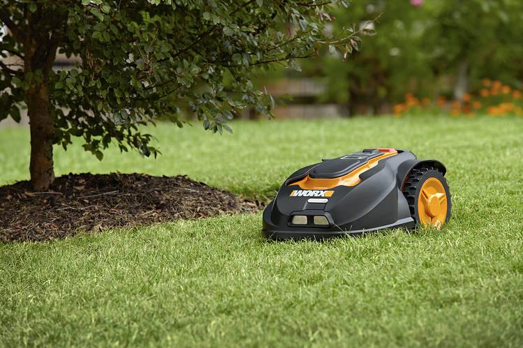 Robotic lawn mower in garden