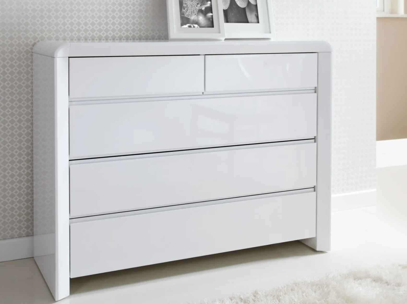 A white dresser in a room