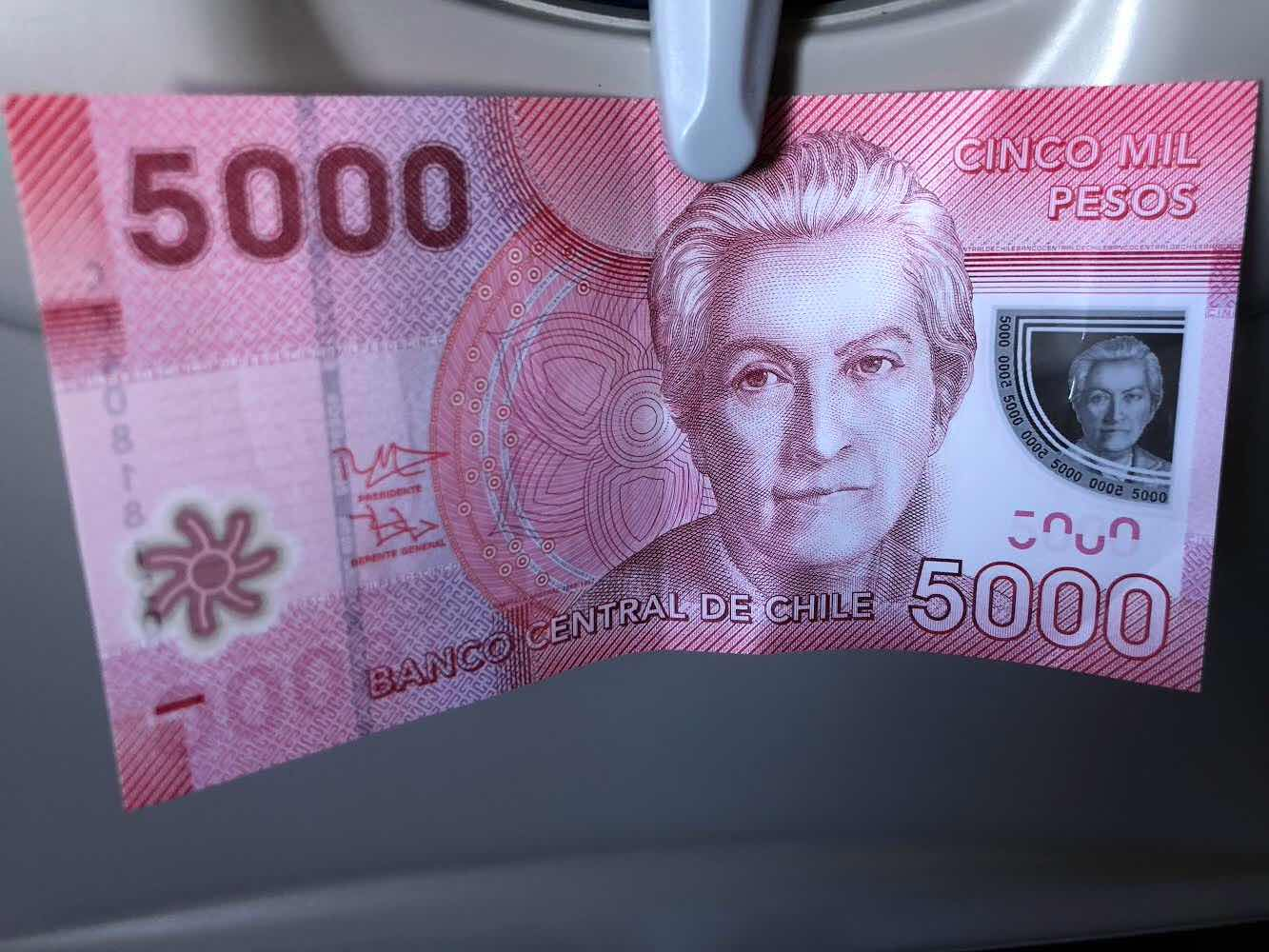 5000 peso Chilean note with Gabriela Mistral image in transparent section