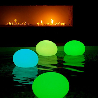 Glowing balloons floating in the water