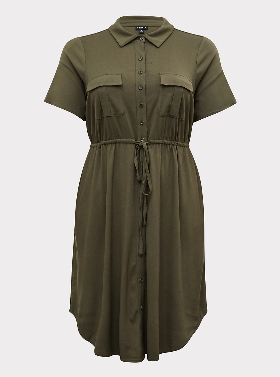 one of the best things to wear while photographing a wedding - a stylish dress with pockets in a neutral color