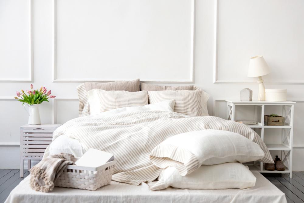white bedding in white bedroom