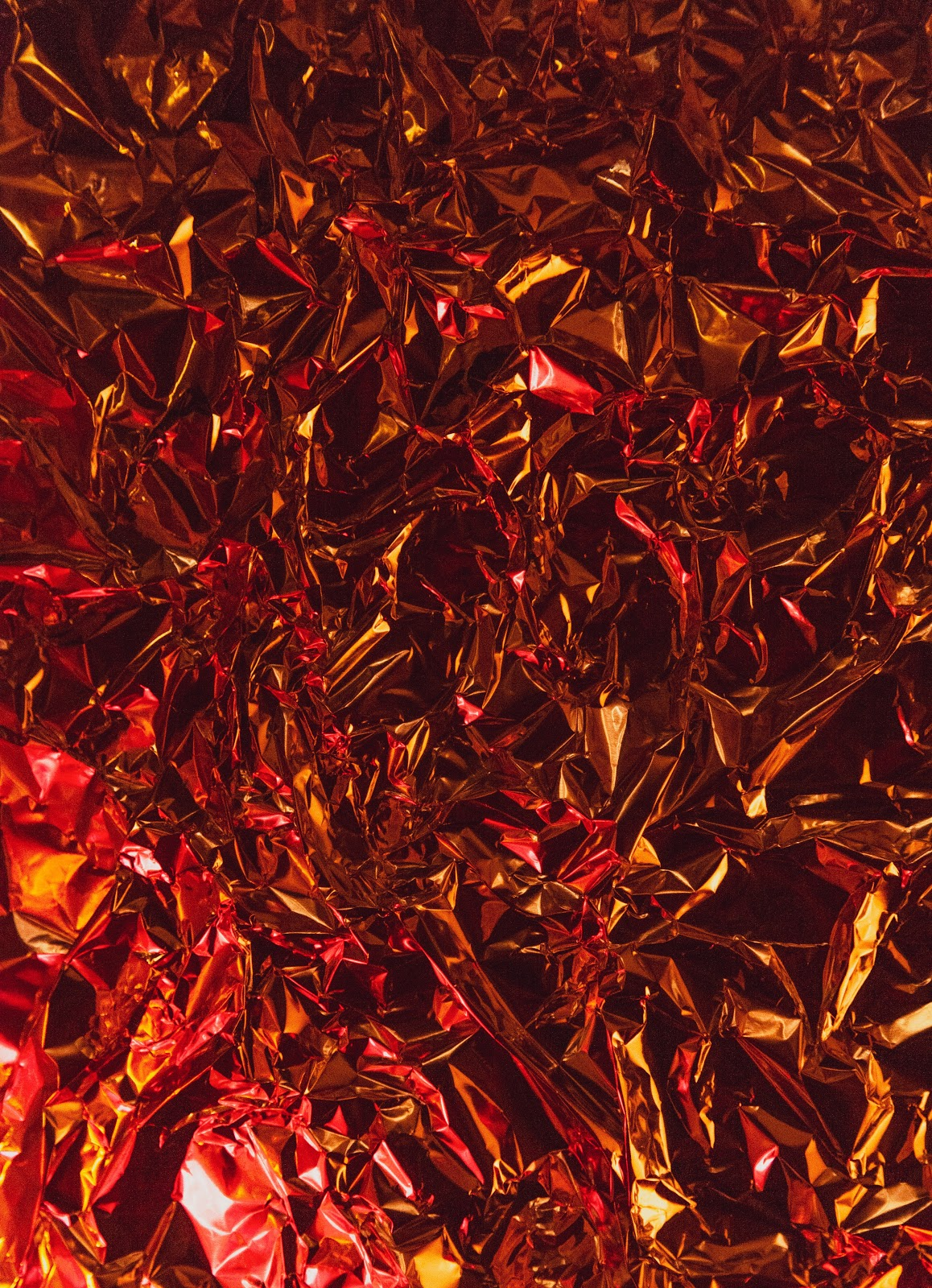 Red metallic foil crinkled