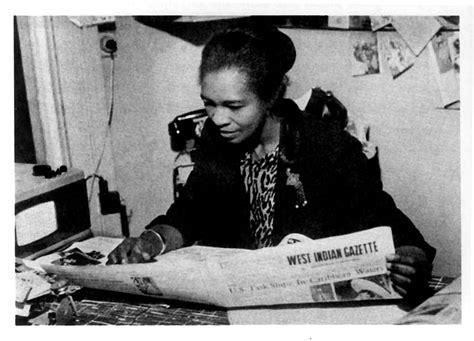 Claudia Jones with her newspaper