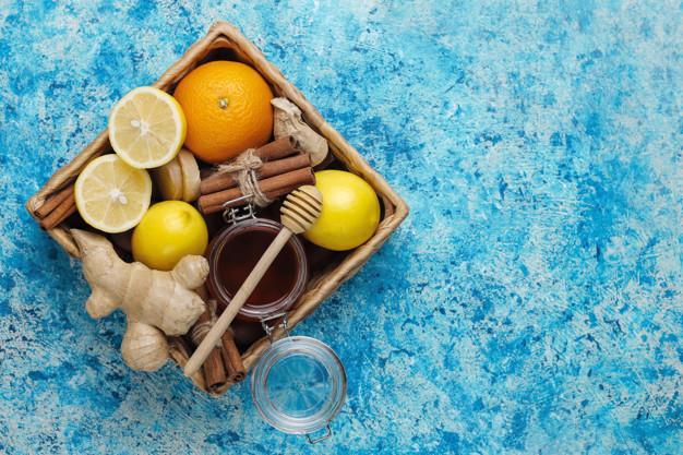 Ingredients: fresh ginger, lemon, cinnamon sticks, honey, dried cloves for making immunity boosting healthy vitamin drink Free Photo