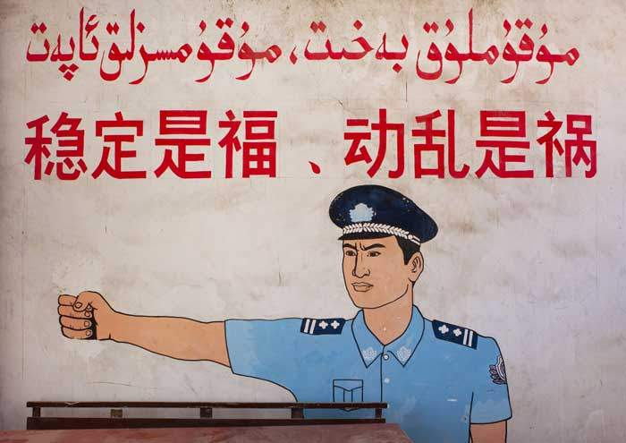 """A wall poster in Xinjiang reads: """"Stability is a blessing, instability is a calamity"""""""
