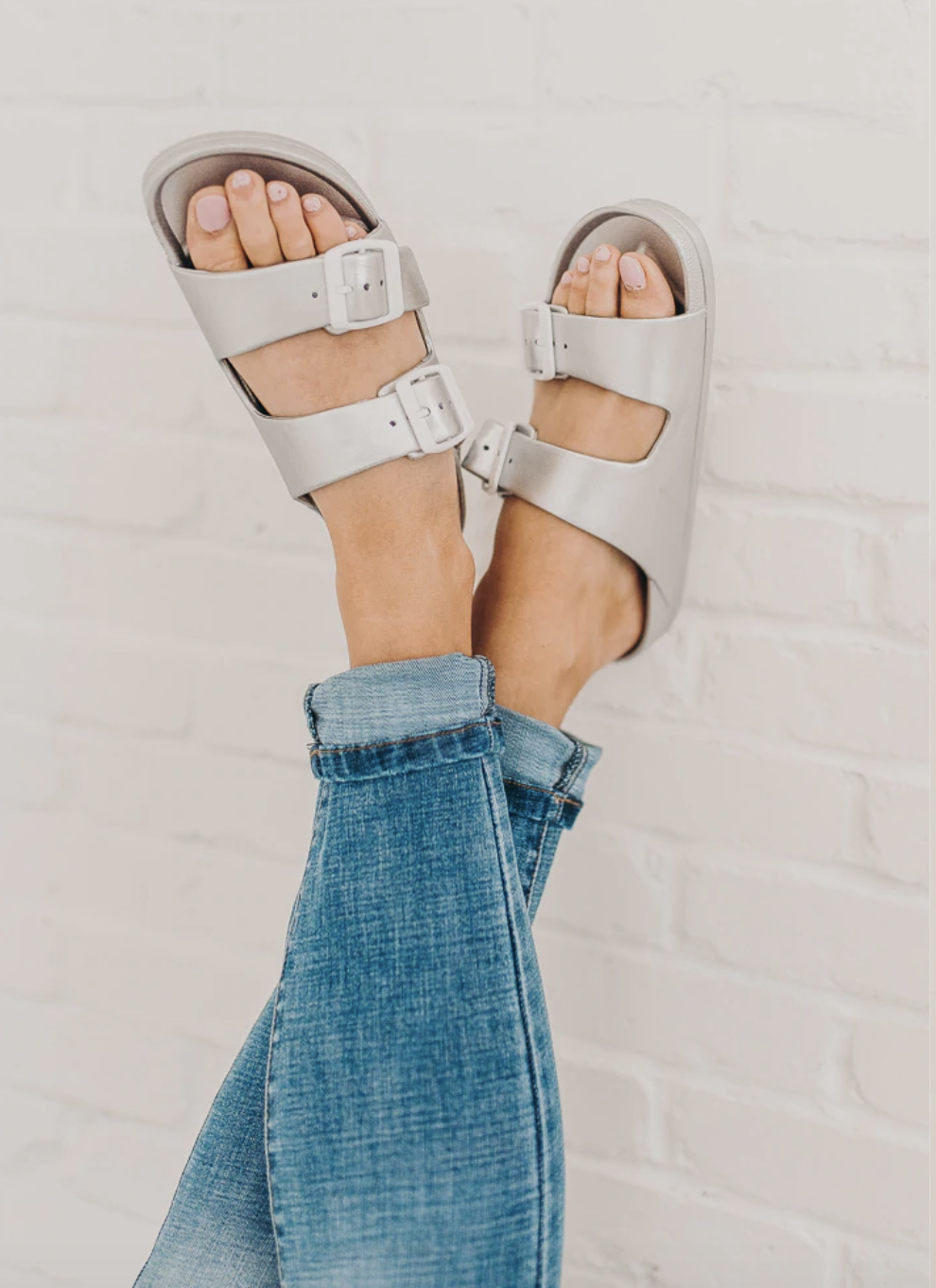 Open toed sandals with double strap and buckle detail.