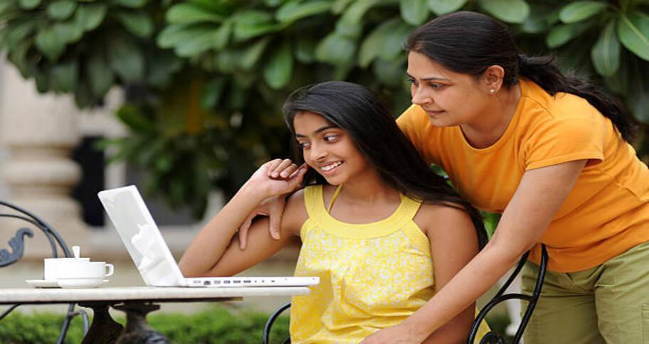 kids with their parents exploring how to study coding