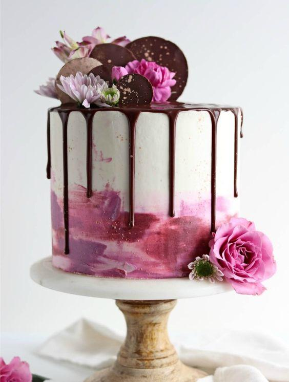 A drip cake is so versatile, fun and darn tempting that it's easy to see why everyone loves them. The luxcious chocolate running down the sides of colorful buttercream is everything you want in a cake and (almost) too pretty to eat. These 11 dreamy drip cakes are quite easy to make and will be the star of the show! This is a must pin! #xokatierosario #dripcakes #dripcaketutorials #cakeideas