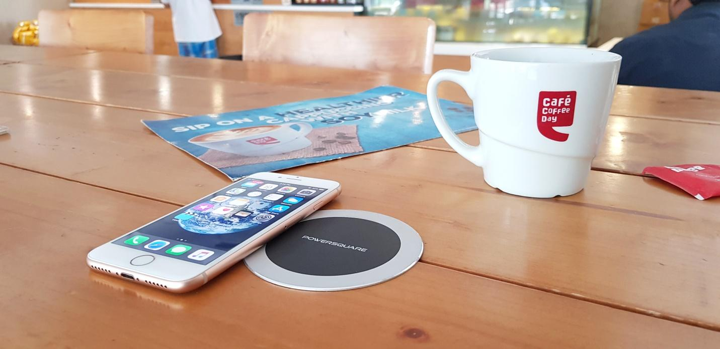 PowerSquare Wireless Charging Spot and an iPhone 8 at Cafe Coffee Day
