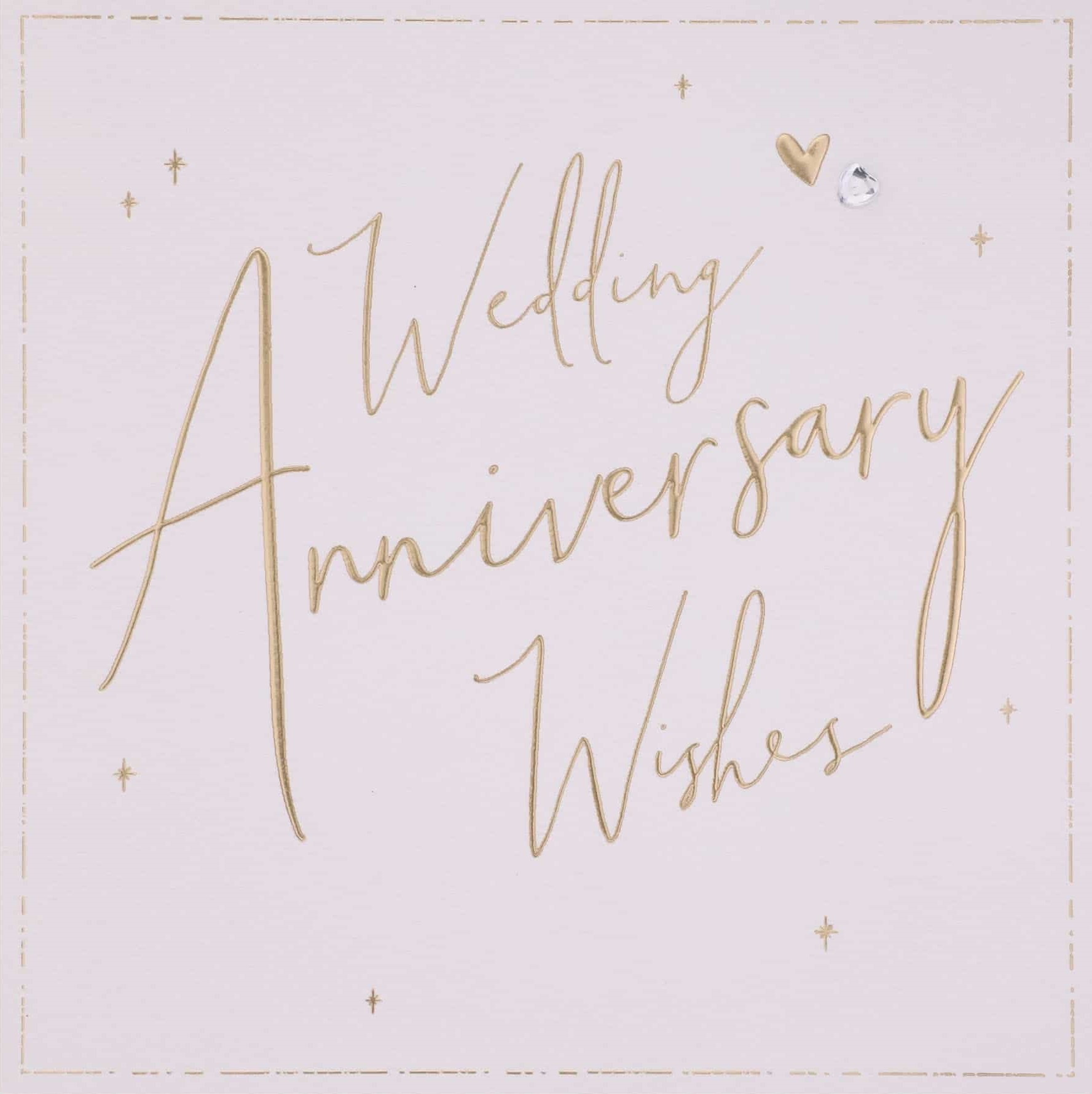 A blush pink card with 'Wedding Anniversary Wishes' printed on it in gold.