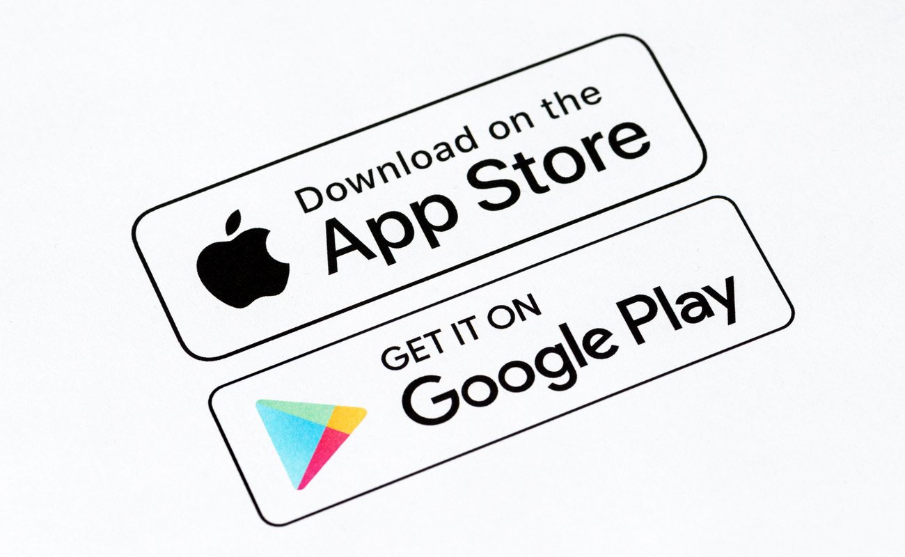 Close-up shot of App Store and Google Play download buttons