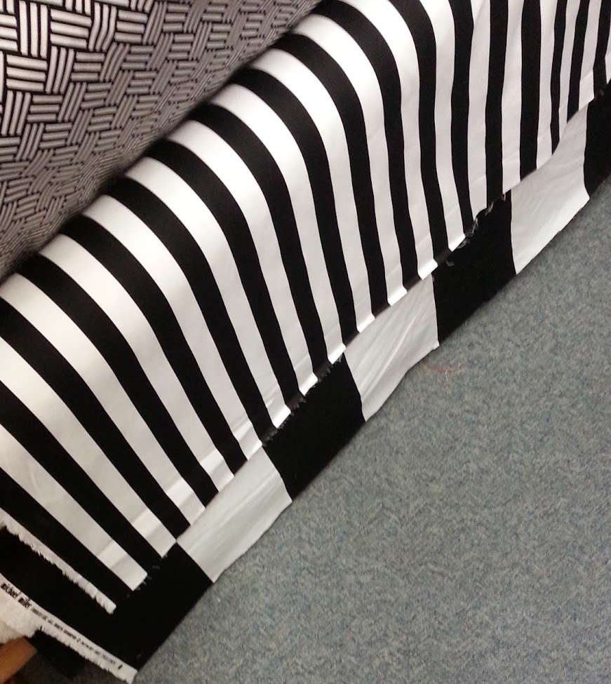 Black and white drapery fabric on bolts at a fabric store