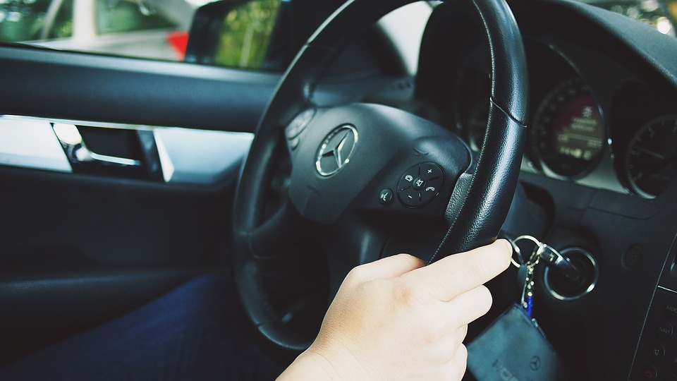 hand on car steering wheel when taking control demand of your business