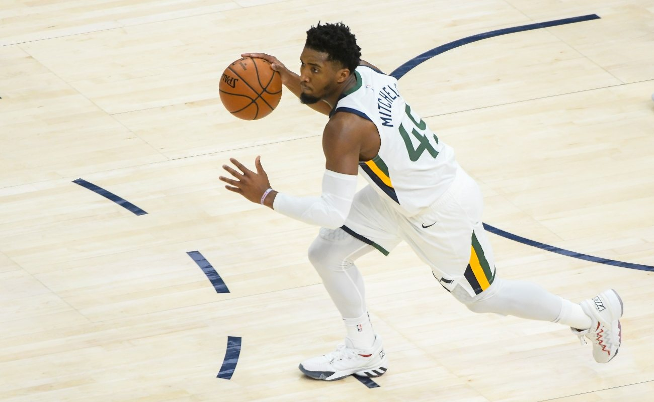 Donovan Mitchell #45 of the Utah Jazz controls the ball during a game against the Phoenix Suns at Vivint Smart Home Arena on December 14, 2020 in Salt Lake City, Utah. (Photo by Alex Goodlett/Getty Images)