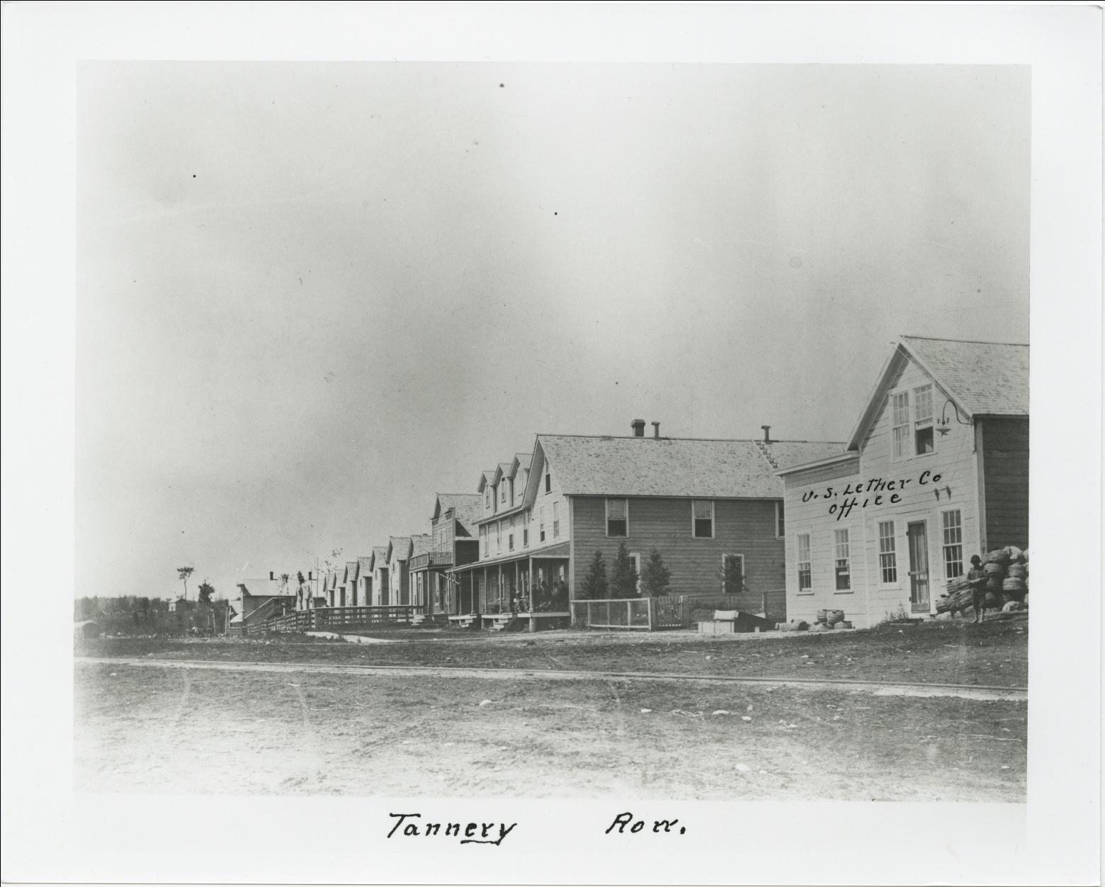 "C:\Users\Robert P. Rusch\Desktop\II. RLHSoc\Documents & Photos-Scanned\Rib Lake History 10700-10799\10788-P. ""Tannery Row"" US Leather Co. office, view west, dow.jpg"