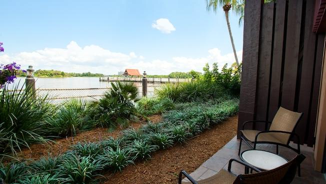 Outdoor furniture on a patio and, beyond, Seven Seas Lagoon