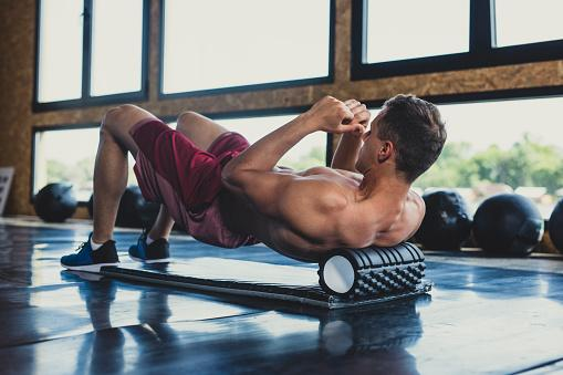 https://media.istockphoto.com/photos/athlete-using-a-foam-roller-picture-id1194299468?b=1&k=6&m=1194299468&s=170667a&w=0&h=sK4TDAVUu2ocebse9sVt93xVKPgW1Aj4Yu34FNjRhIo=