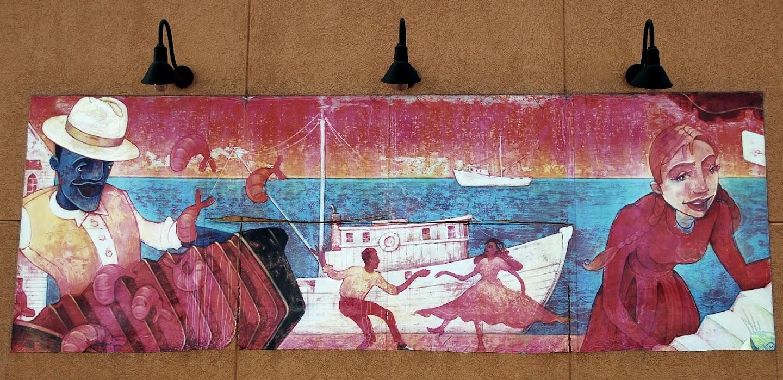 Wall art depicting a Louisiana coastal scene on the wall of a Popeyes Lousiana Grill restaurant in Kentucky