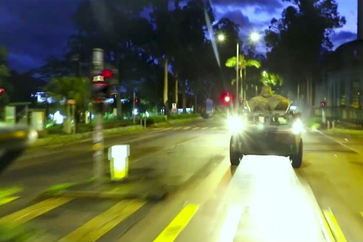 A PLA armoured personnel carrier drives down a Hong Kong street. Photo: Weibo