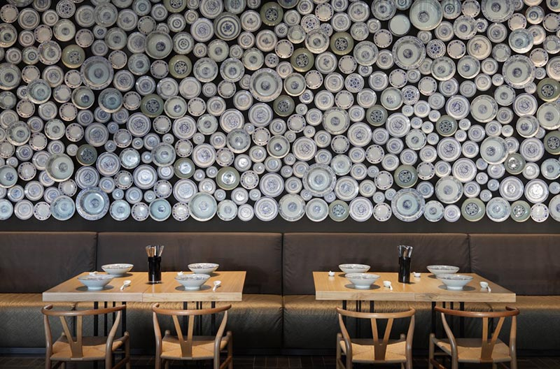 Plate covered wall at the Taiwan Noodle House in Beijing, China.