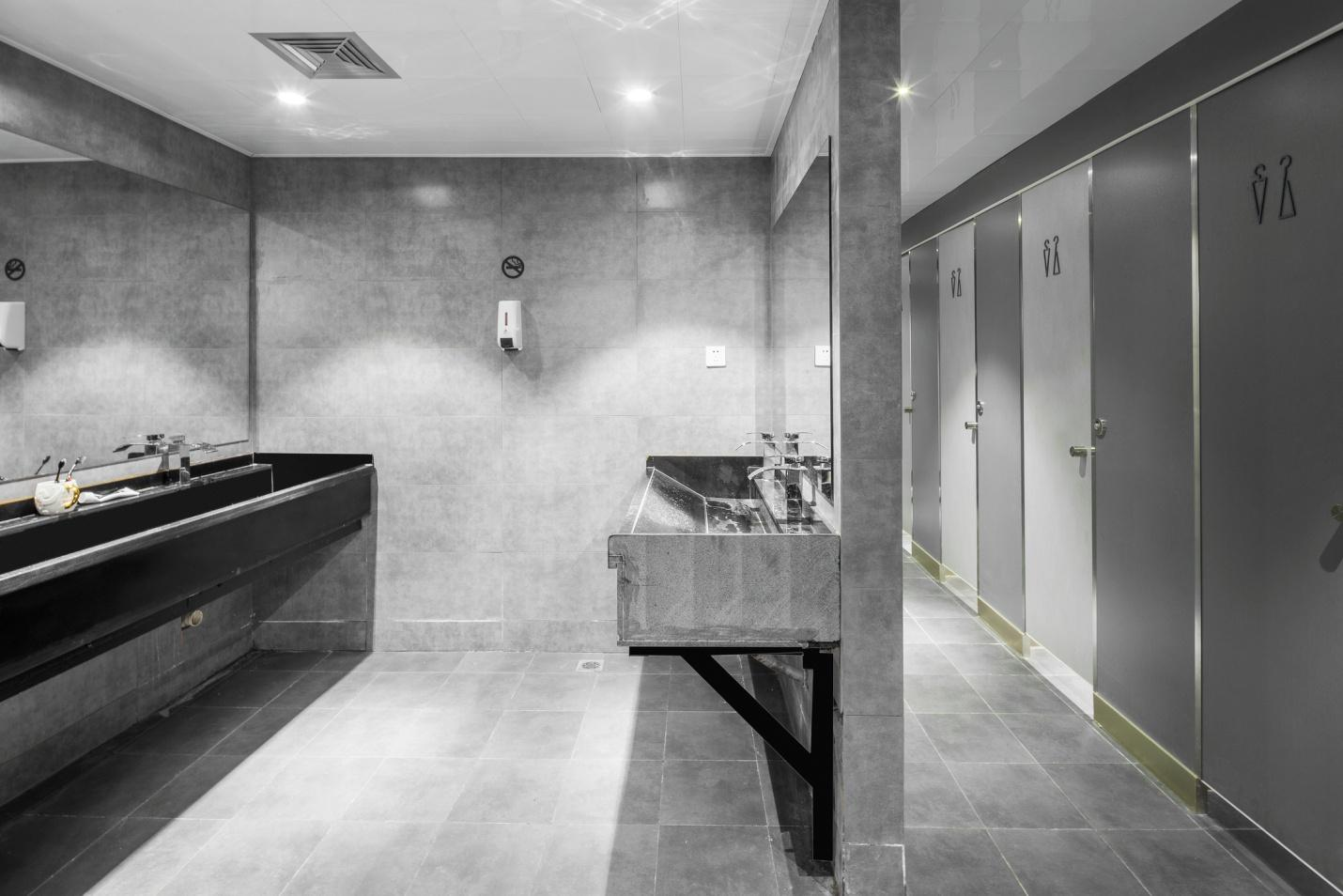 Interior of modern commercial bathroom stalls and partitions