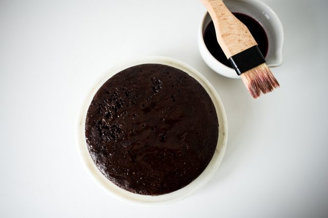 Glaze the first cake layer with syrup.