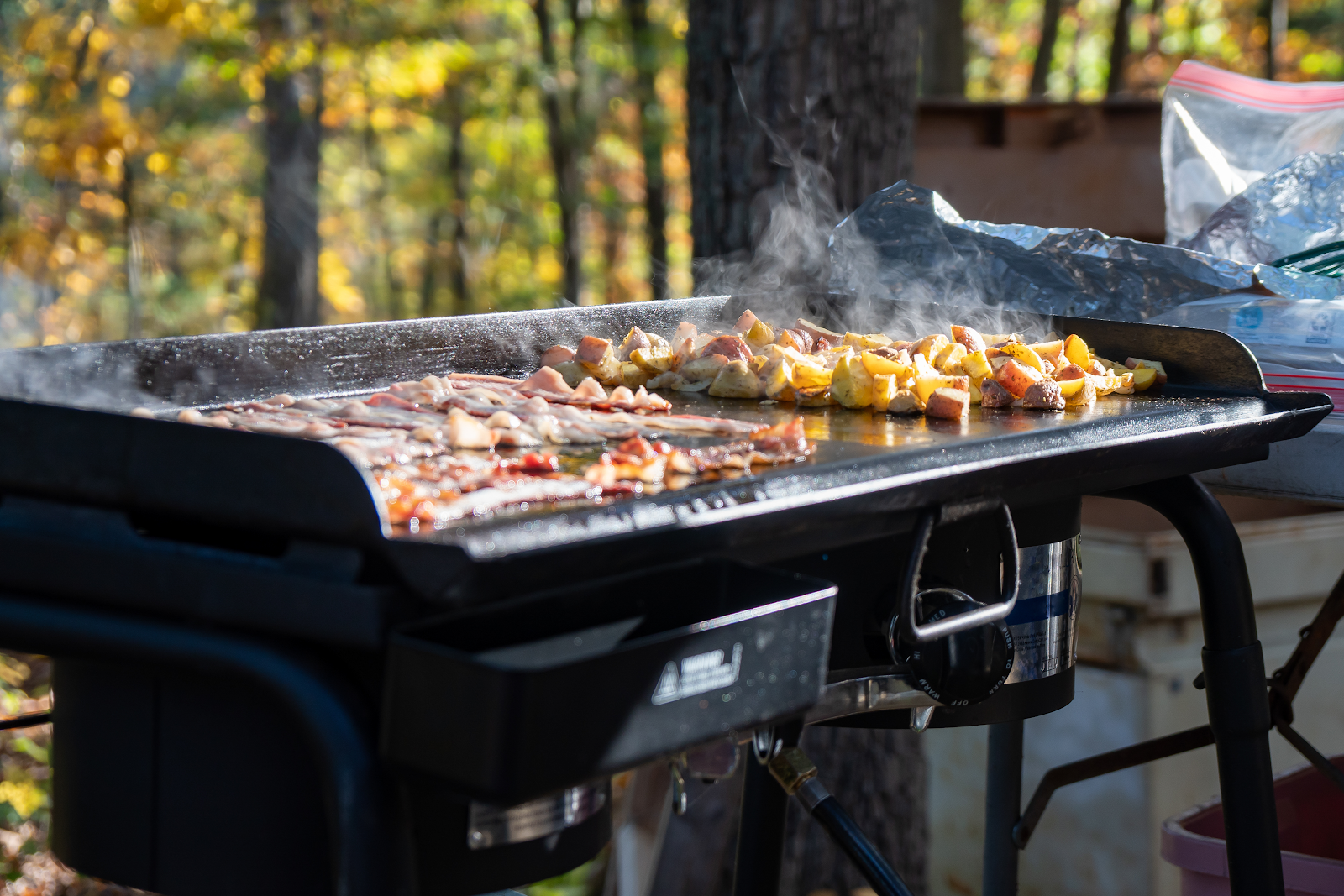 Food cooking on a flat top outdoor griddle