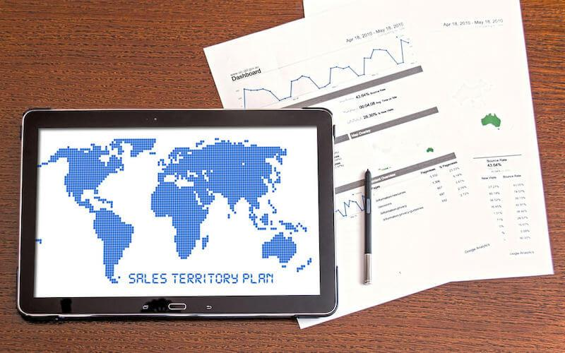 """Photograph of tablet and paper with text reading """"sales territory plan"""""""
