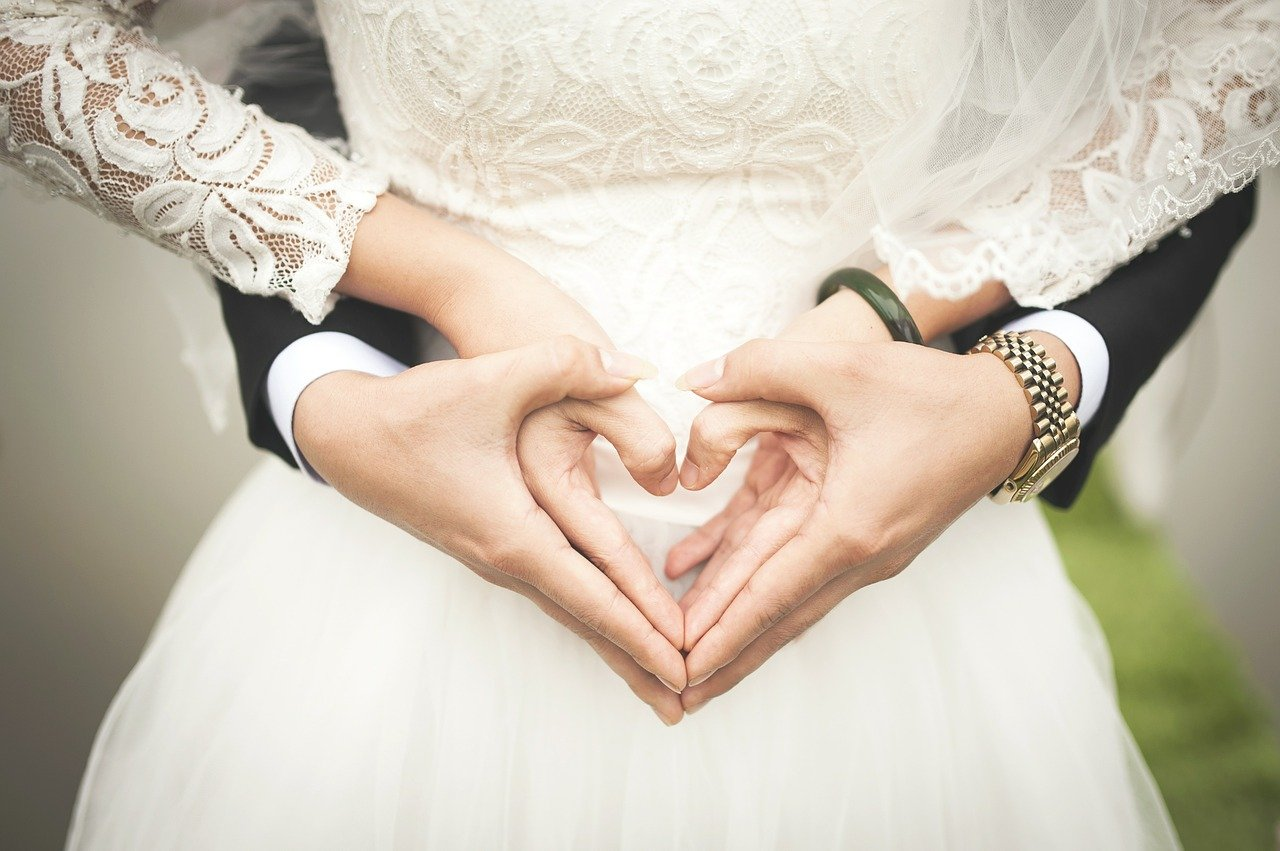 Bride and Groom making a heart with their hands