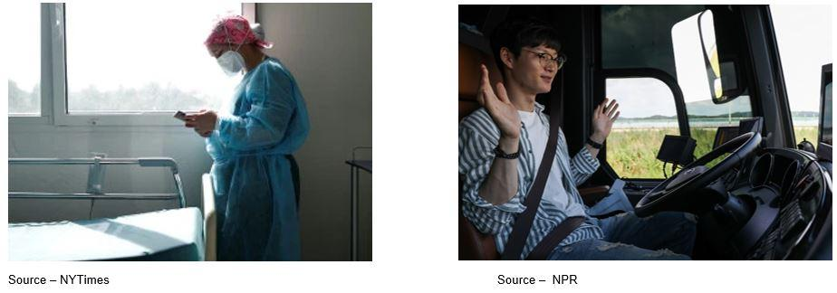 A picture containing man, photo, looking, woman  Description automatically generated
