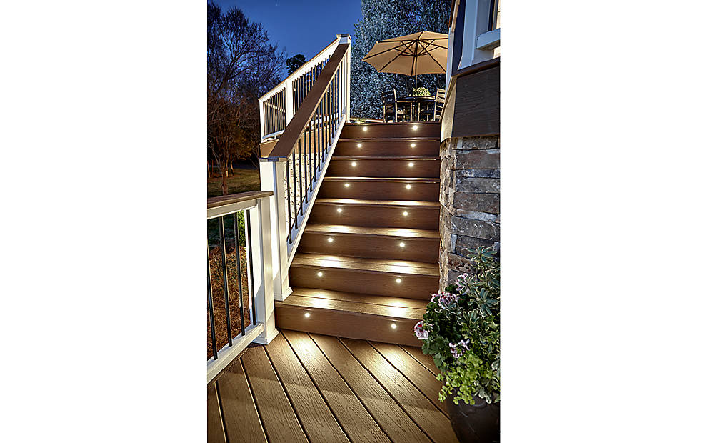 light up stairs leading up to wooden deck at night