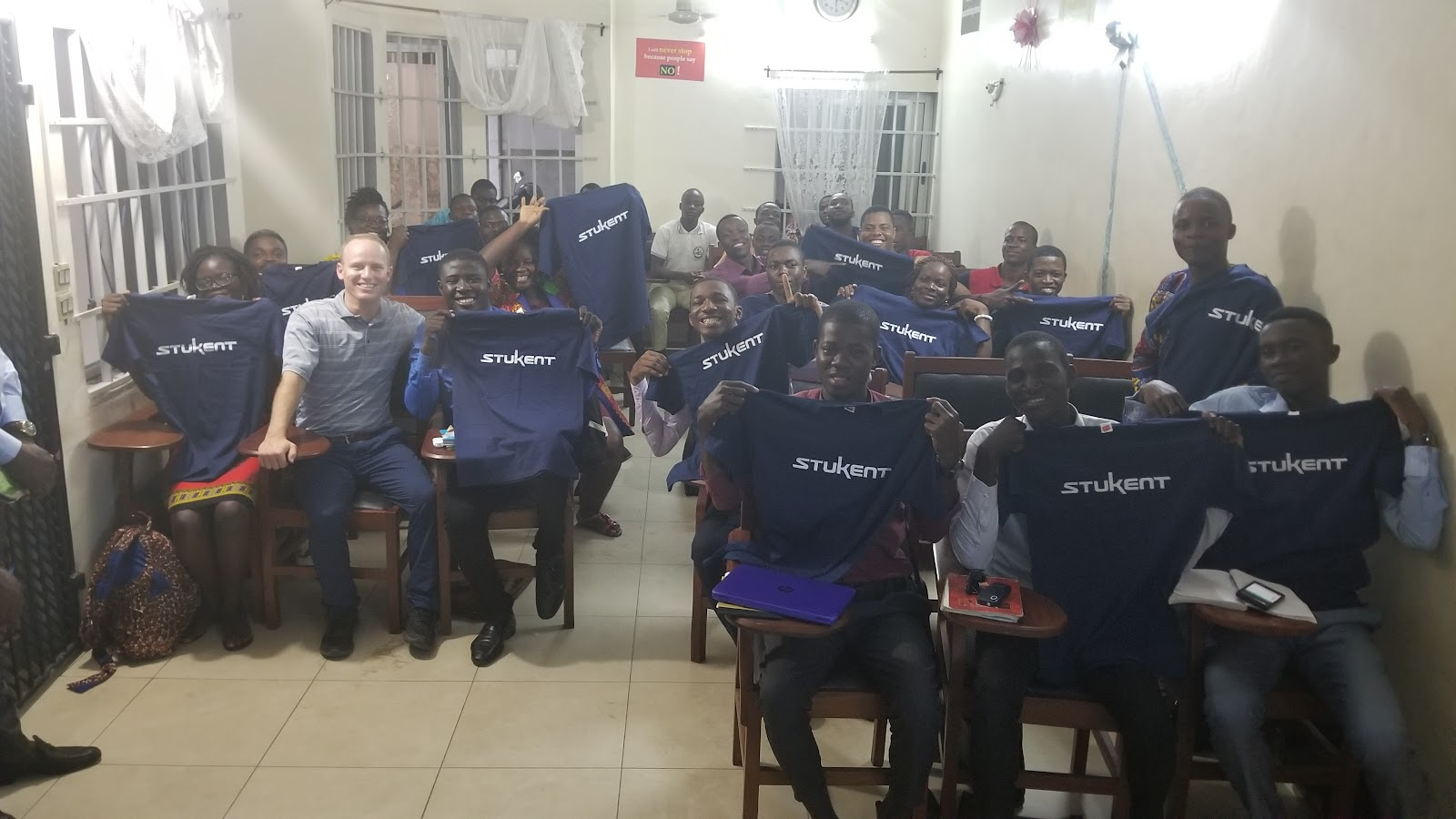Stukent CEO Stuart Draper with one of the VELI classes in Benin.