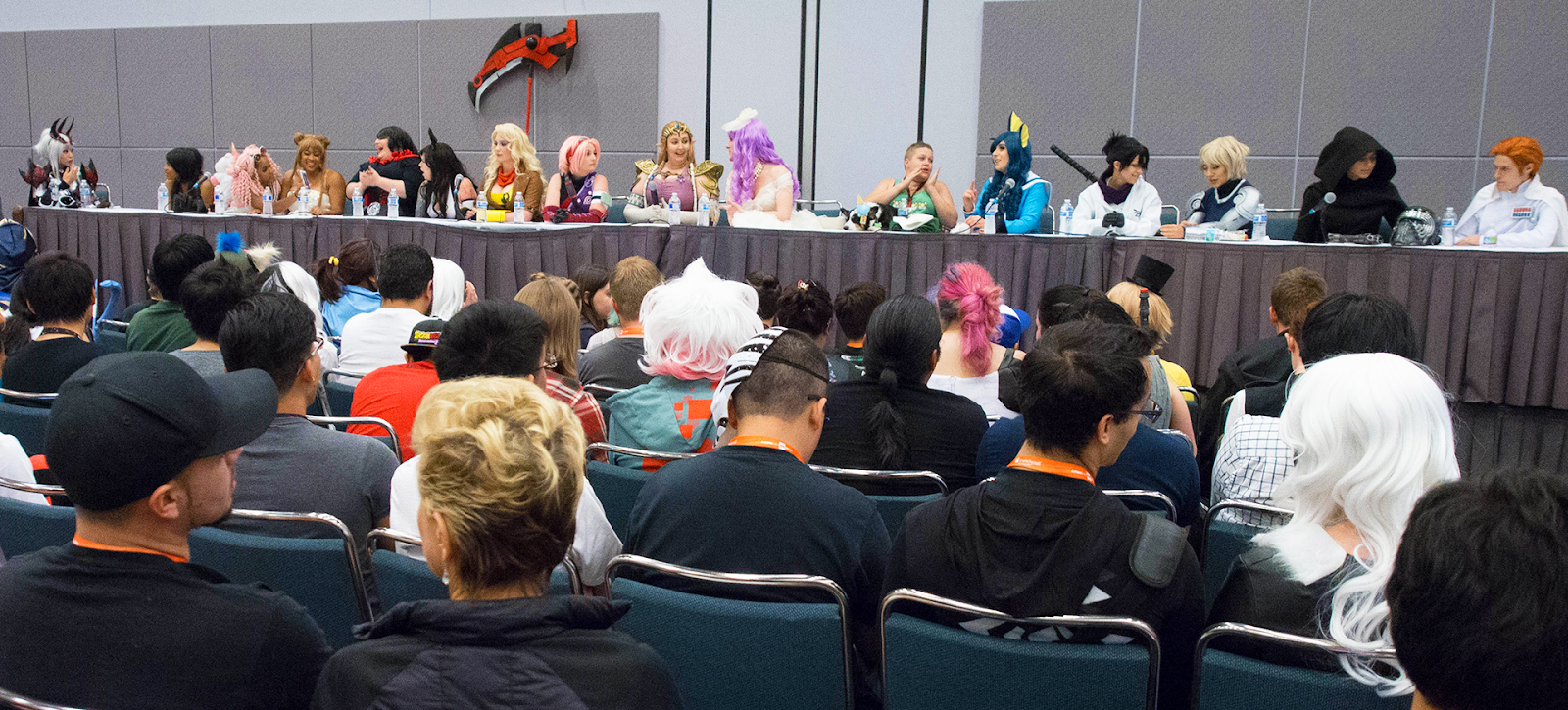 convention attendees with cosplayers