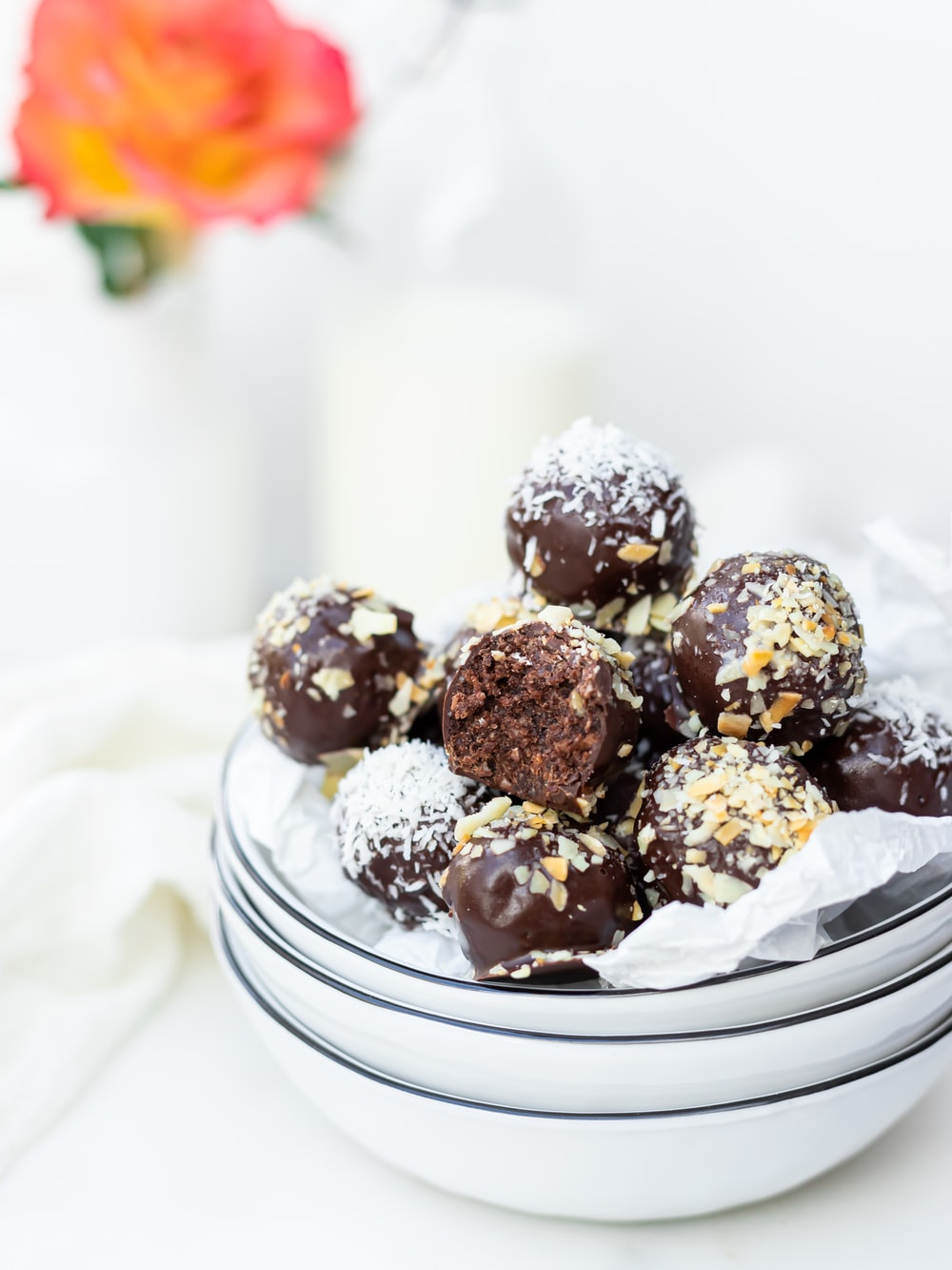 chocolate truffles made with wholesale chocolate chips on a white ceramic plate