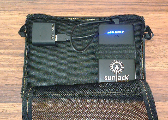 SunJack 14W with 2 proprietary USB ports and removable battery (blue lights indicate current battery capacity).