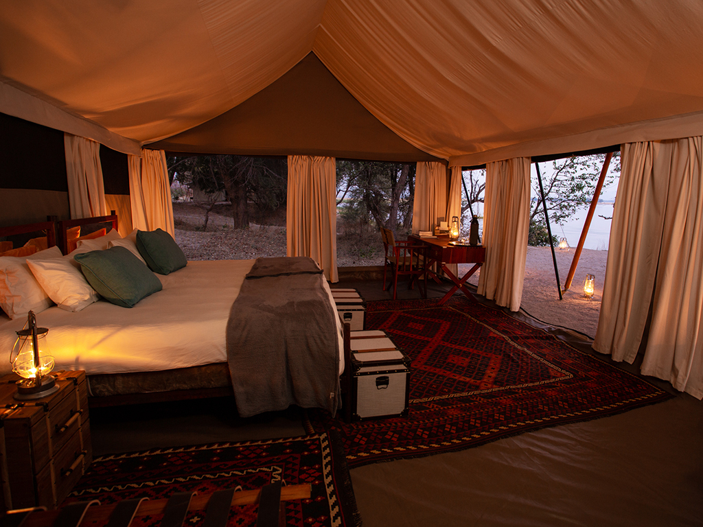The perfectly decorated tent with oriental rugs in a safari tent in Mana Pool