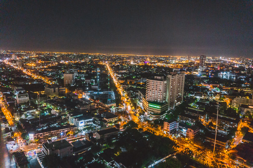 City lights glowing throughout Bangkok from a rooftop bar.