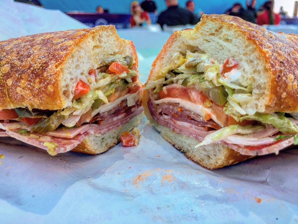 Photo of the Godmother sandwich complete with Genoa salami, mortadella, ham, prosciutto and provolone from Bay Cities Italian Deli in Santa Monica, CA .