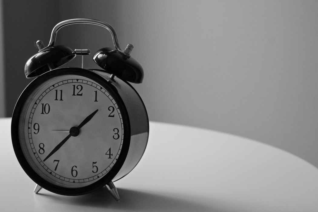 black and white photography of alarm clock displaying 1:37 time
