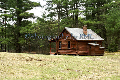 log cabin in the early spring