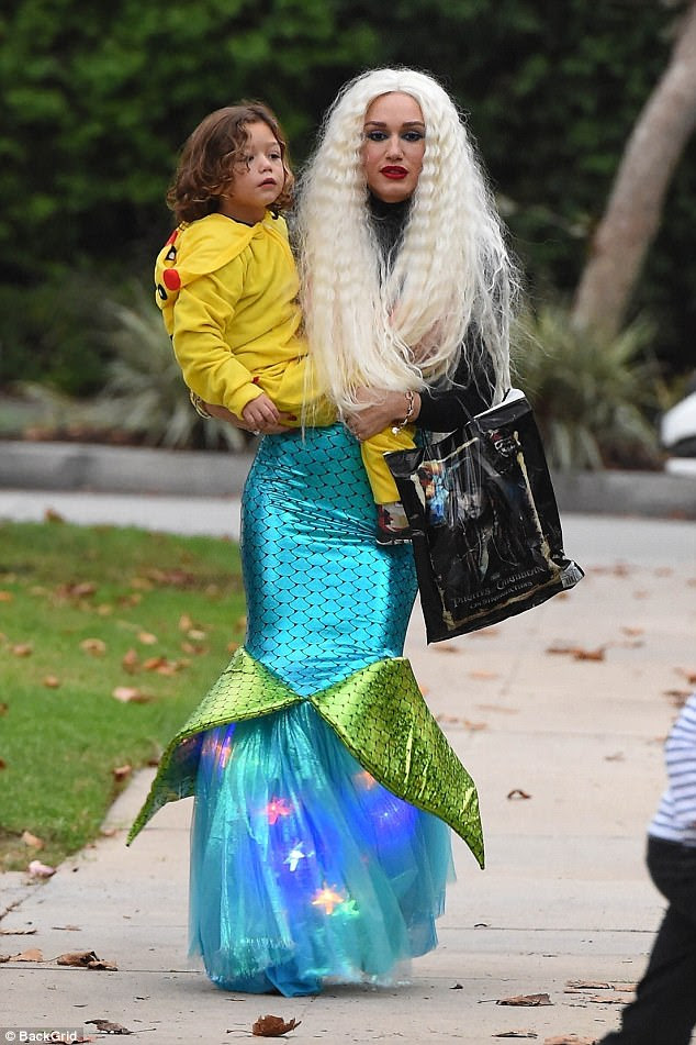 Making a splash! Gwen Stefani transformed into a mermaid as she took her sons Zuma and Apollo out trick-or-treating on Halloween on Tuesday