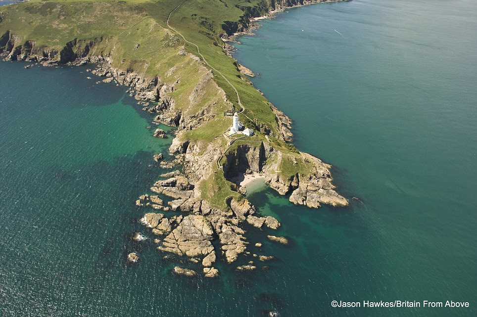 Nooks and crannies: A lighthouse looks out over a rugged stretch of Britain's coast