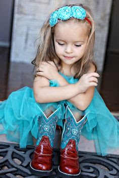 So precious! We love the red boots with the turquoise. Very classy! #Cute #LittleCowgirl #CowgirlBoots