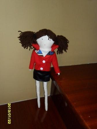 muñeca con chupa